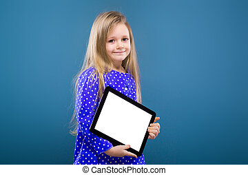 Adorable little girl in purple dress hold empty tablet