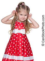 Adorable little girl in the polka dot dress