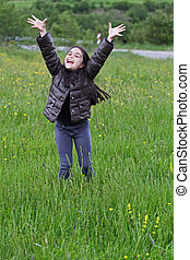 Adorable little girl jumping and having fun