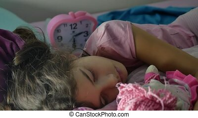 Adorable little girl night sleep in the sofa bed and hug her...