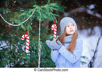 Adorable little girl on Christmas in winter day