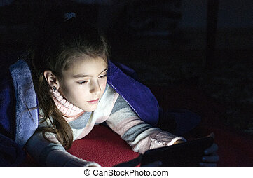 Little girl playing tablet pc