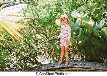 Adorable Little Girl Posing Lush Tropical Vegetation