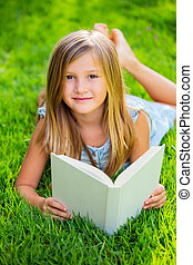 Adorable little girl reading book