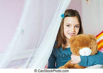 Adorable little girl resting in her room