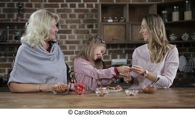 Adorable little girl sharing homemade cookies - Joyful...