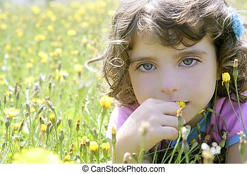 Adorable little girl smell flower in meadow - Adorable ...
