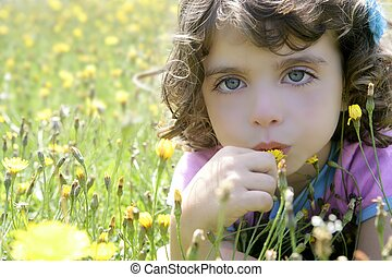 Adorable little girl smell flower in meadow