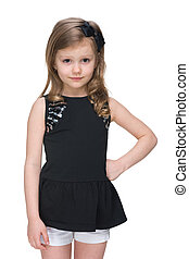 Adorable little girl stands against the white