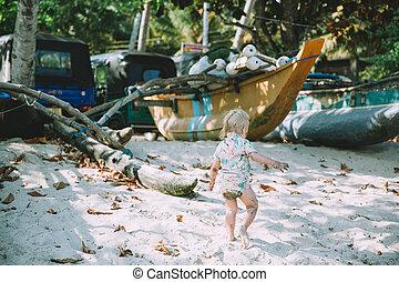 Adorable Little Girl Walking Sandy Beach Boats Background