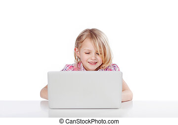 Adorable little girl with a laptop