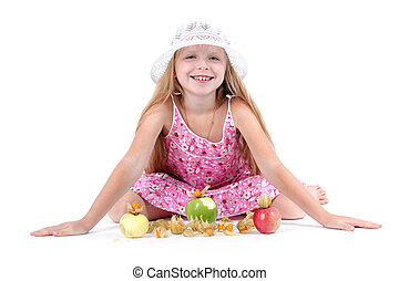 adorable little girl with apple and gooseberry (physalis)