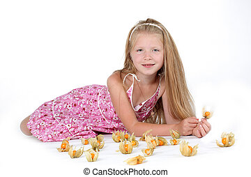 adorable little girl with Cape gooseberry (physalis)