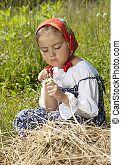 Adorable little girl with chamomile flowers