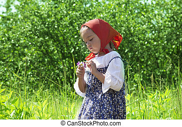Adorable little girl with flower in her hands