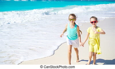 Adorable little girls at beach during summer vacation -...