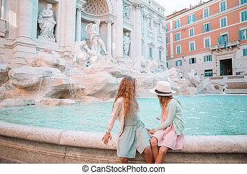 Adorable little girls near the Fountain of Trevi in Rome.
