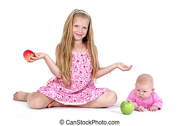 adorable little two sisters 8 year and 3 month ols with apple