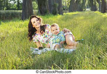 Adorable mom realxing with her cute baby