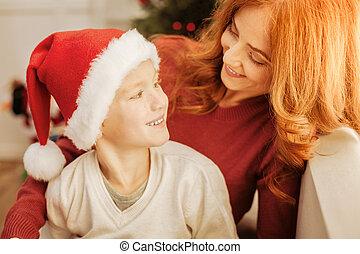 Adorable mother and son enjoying christmas morning together