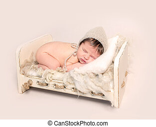 Adorable newborn baby sleeping on his stomach