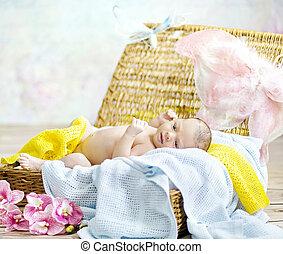 Adorable newborn child lying on soft blanket