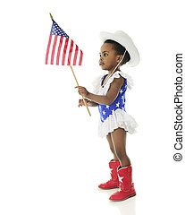 Adorable Patriot - An adorable African American girl looking...