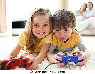 Adorable playing video game