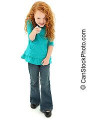 Adorable Preschool Girl Child Pointing Playfully Towards Camera