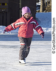 Adorable preschooler (4 years old) iceskating for the first time