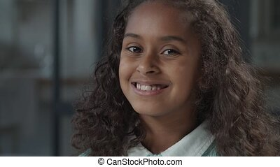 Adorable preteen black girl with toothy smile - Closeup ...