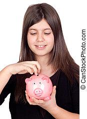Adorable preteen girl with money box - Adorable preteen girl...