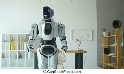 Adorable robot dancing in office - Time to relax. New...