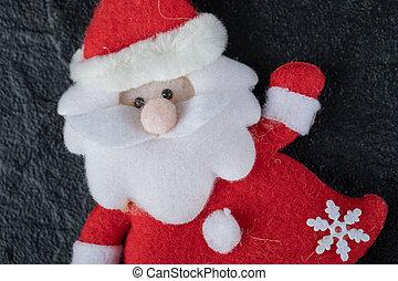 Adorable Santa figure on dark background