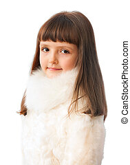 adorable seven years girl in fur coat isolated on white background