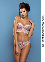 Adorable sexy shapely brunette woman in a floral lingerie...