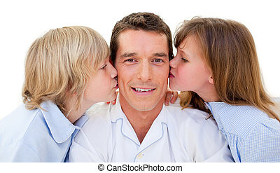 Adorable siblings kissing their father against a white...