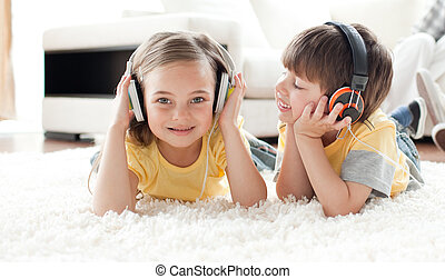 Adorable siblings playing on the floor