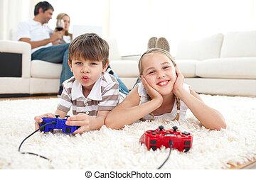 Adorable siblings playing video games