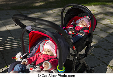 sleeping twins baby in double stroller
