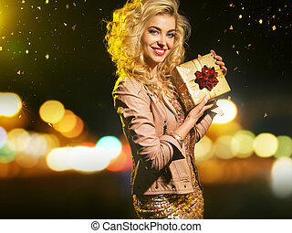 Adorable smart woman holding the gift