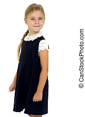 Adorable smiling girl posing in school uniform