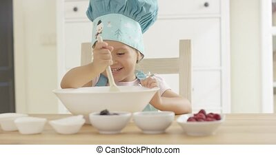 Adorable smiling toddler at mixing bowl - Adorable smiling...