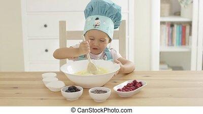 Adorable smiling toddler at mixing bowl - Adorable smiling...