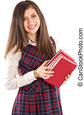 Adorable student holding a pile of books