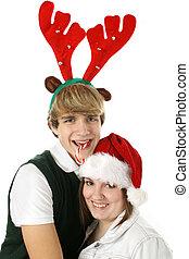 Adorable Teen Couple in Christmas Hats.
