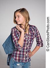 Adorable teen girl looks back