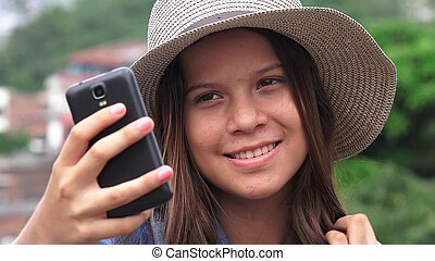 Adorable Teen Girl Making Selfies
