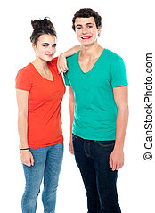 Adorable teenage couple in casuals