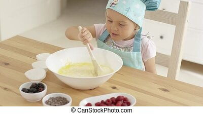 Adorable toddler at mixing bowl - Adorable single toddler in...